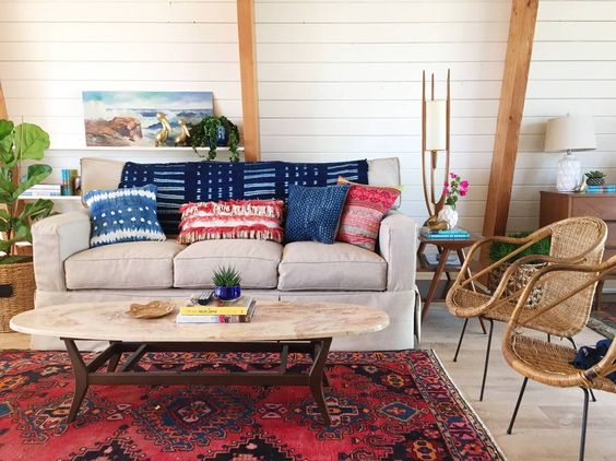 Love the colorful vintage textiles and rug in this mid century beach house kellyelko.com