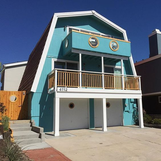 Whimsical Beach House - she turned this 1970's A-frame house into a colorful, eclectic, mid century beauty! kellyelko.com