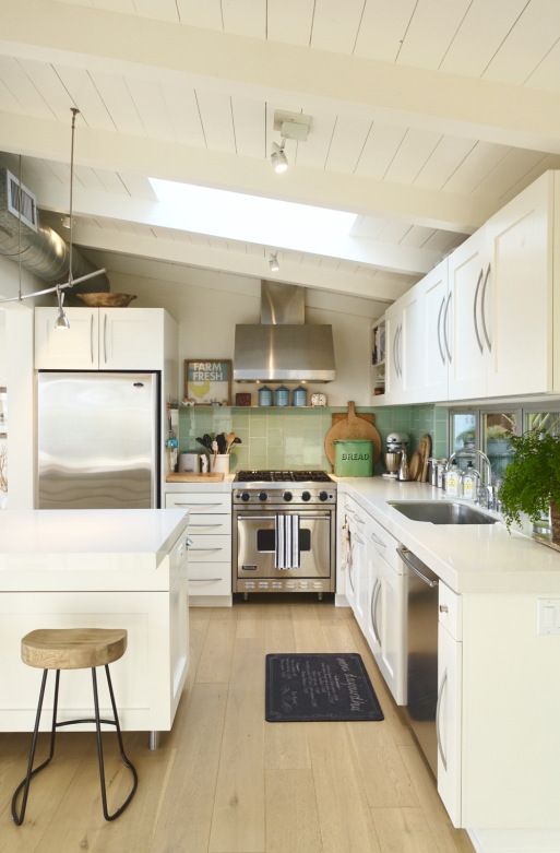 Small white kitchen big on style - love the planked ceiling and green glass tile backsplash kellyelko.com