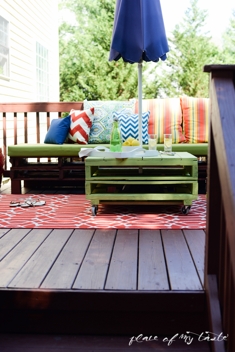 DIY pallet coffee table and colorful deck kellyelko.com