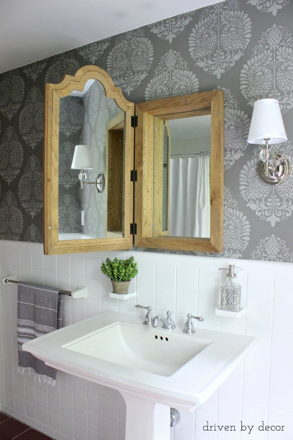 Love this wood mirrored medicine chest and the stenciled walls in this gray and white bathroom kellyelko.com