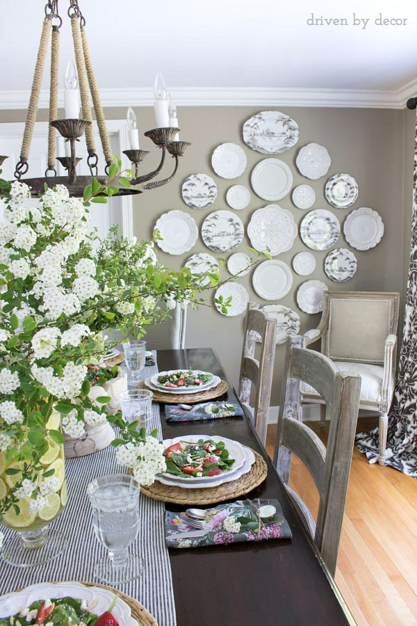 Gorgeous black and white plate wall in gray dining room kellyelko.com