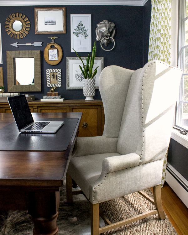 Dramatic dark walls in this home office with large desk and wing back chair kellyelko.com