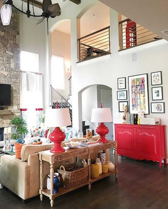 Colorful family room - love the pops of red! kellyelko.com