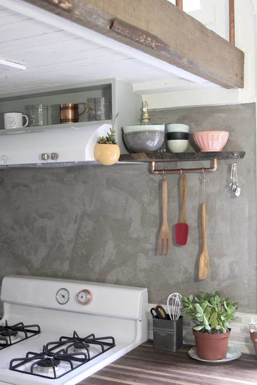 Love the concrete walls in this cool kitchen kellyelko.com