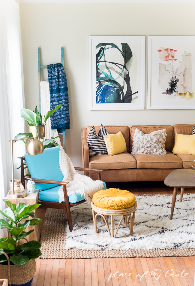 Boho family room - love the mid century sofa and modern art kellyelko.com