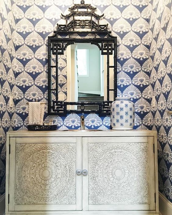Love the blue and white wallpaper in this small powder room and the pagoda mirror kellyelko.com