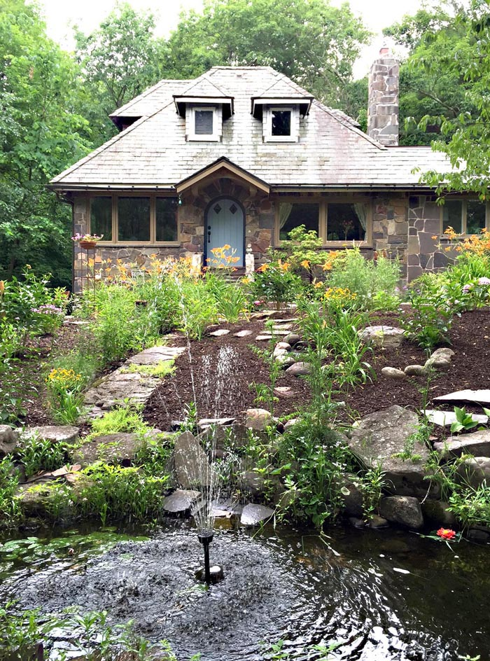 Stone cottage with lush gardens - love the fountain kellyelko.com