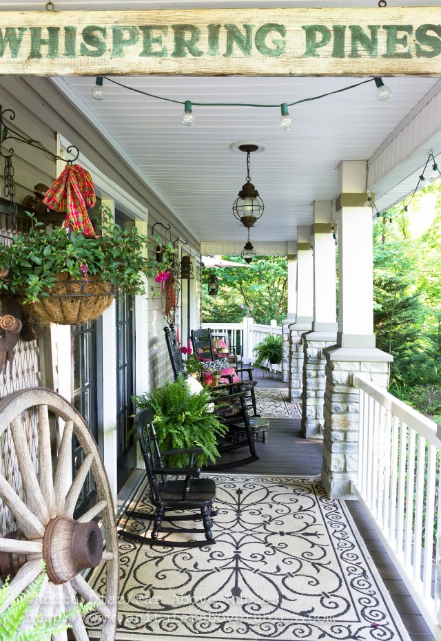 Welcoming front porch - love the antique wood sign an the black rocking chairs kellyelko.com
