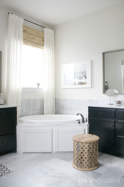 Black and white master bedroom with carrara marble floors kellyelko.com