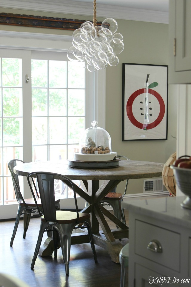 Bubble chandelier over a farmhouse table kellyelko.com