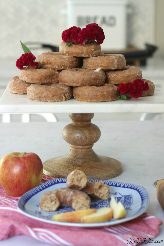 Doughnut tower with flowers - love this for a party! kellyelko.com