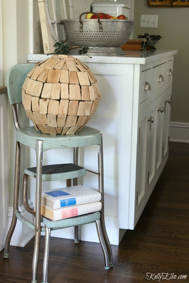 Love this driftwood pumpkin on a vintage step stool kellyelko.com