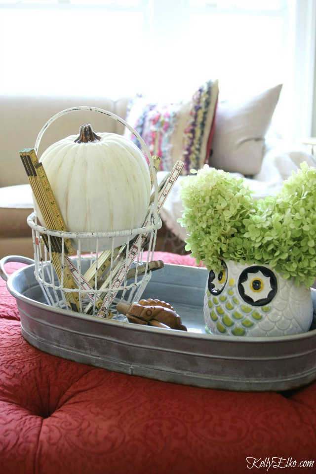 Fall centerpiece - love the bucket of vintage folding rulers and the owl vase kellyelko.com