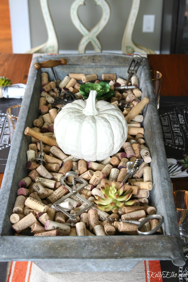 Love this giant zinc trough filled with corks for a fun fall centerpiece kellyelko.com