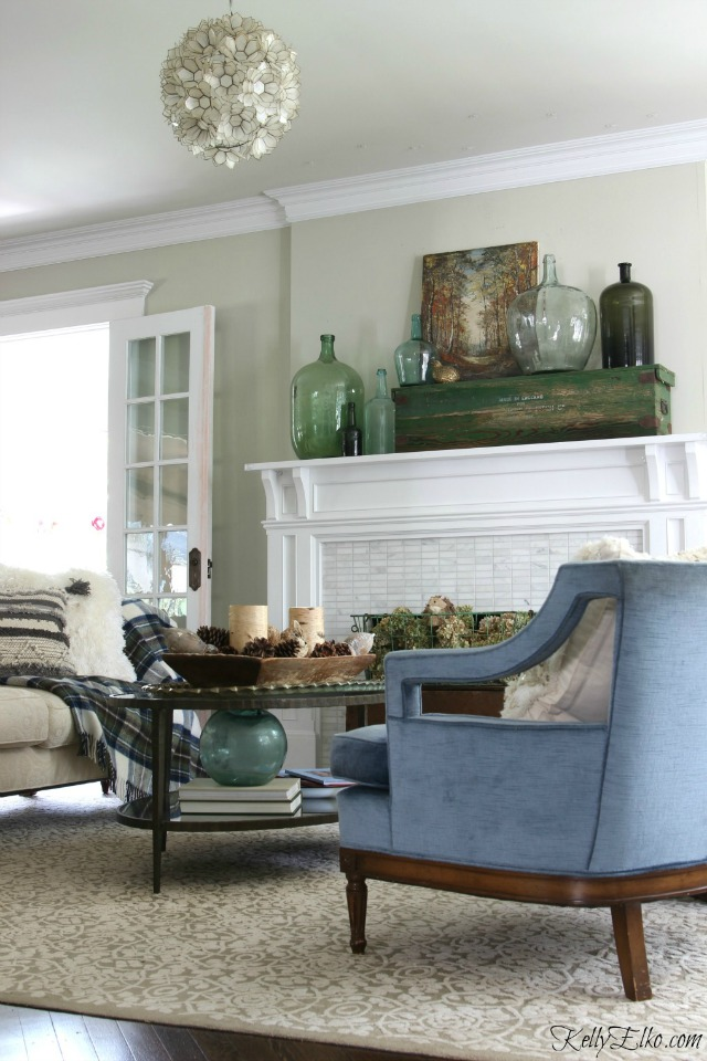 Fall living room - love the glass demijohn collection on the mantel kellyelko.com