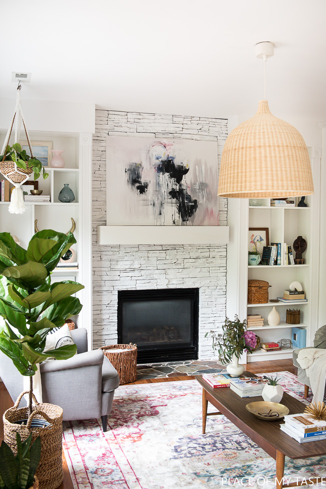 Bohemian living room - love the oversized pendant light and stone fireplace kellyelko.com