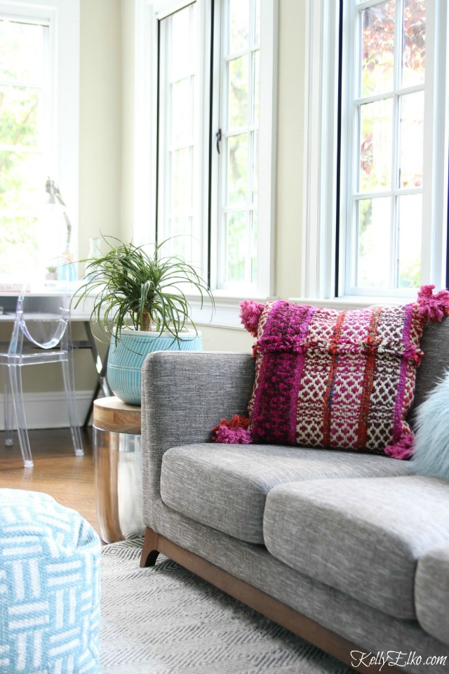 Love this sunroom and gray sofa with fun pink pillow kellyelko.com