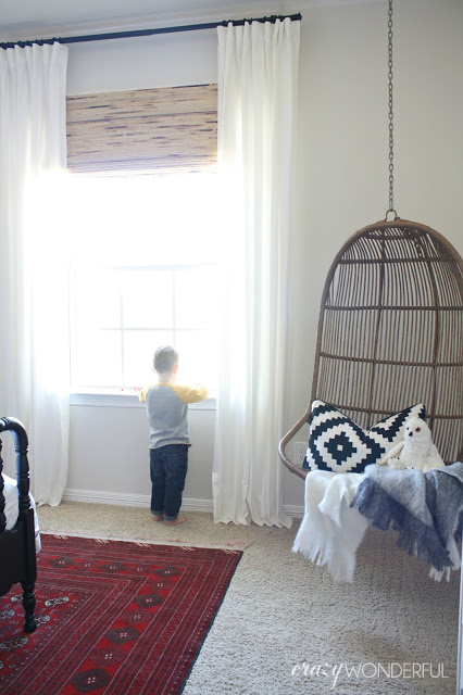 Hanging rattan swing is fun in a kids room kellyelko.com