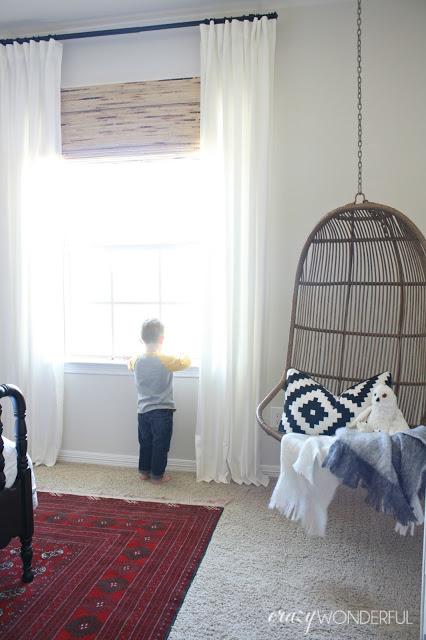 Hanging rattan swing is fun in a kids room kellyelko.com