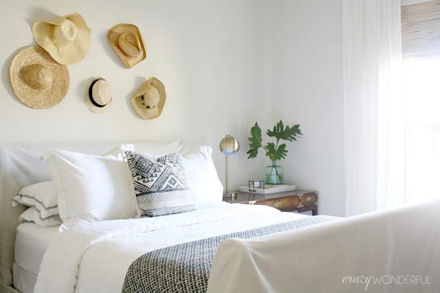 Hats as art in a guest bedroom kellyelko.com