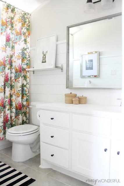 Kids white bathroom with shiplap walls kellyelko.com