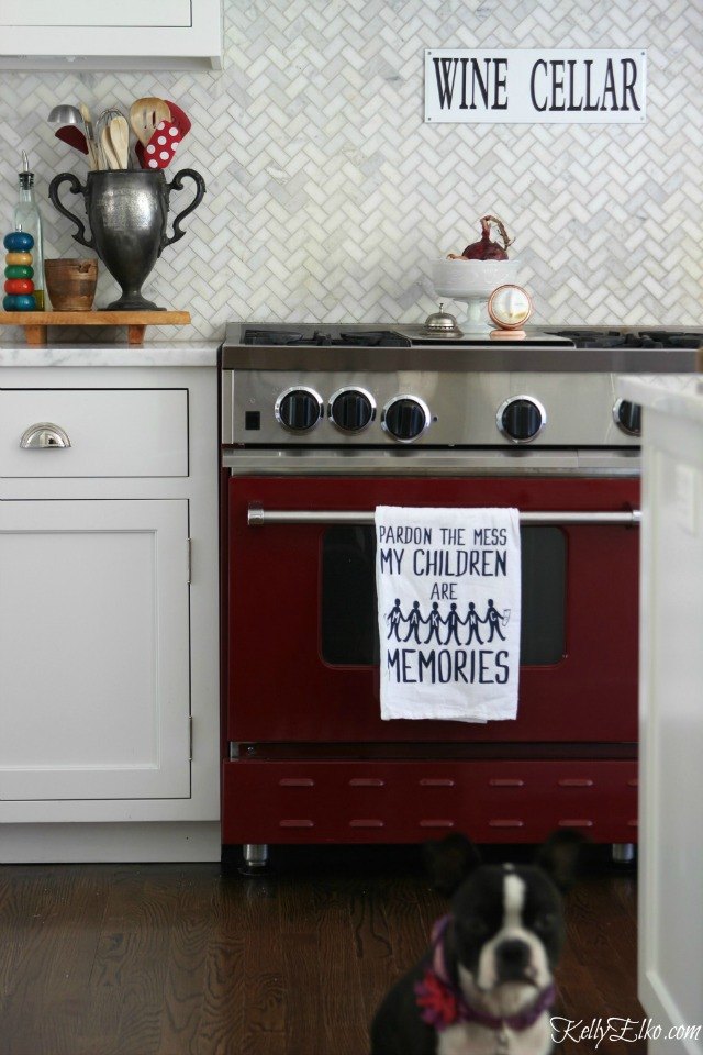 Love this red stove and the herringbone carrara marble backsplash kellyelko.com
