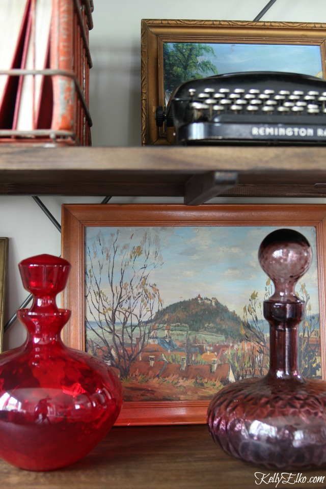 Layer paintings and vintage finds on open shelves kellyelko.com
