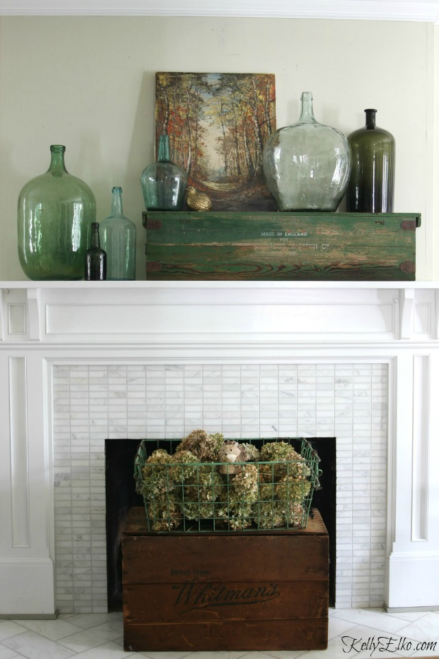 Fall mantel - love the collection of vintage demijohns kellyelko.com