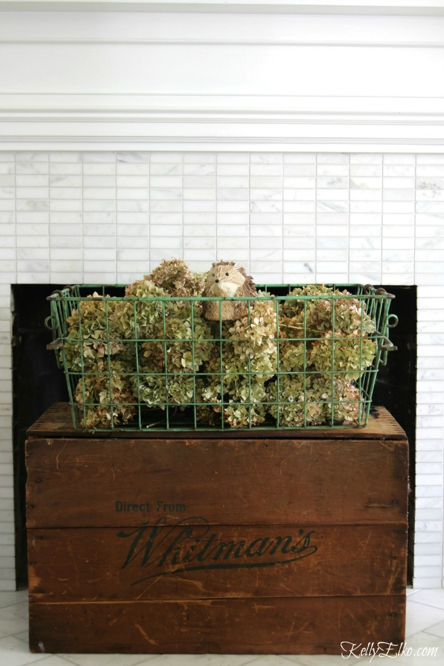 Cover up that black hole of a fireplace with vintage crates kellyelko.com