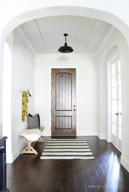 Black and white foyer with dark wood door and floors kellyelko.com