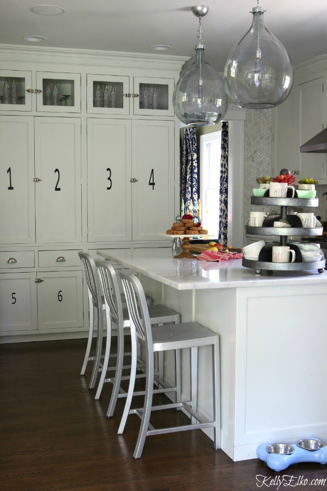 Love this gorgeous white kitchen and the demijohn lights kellyelko.com
