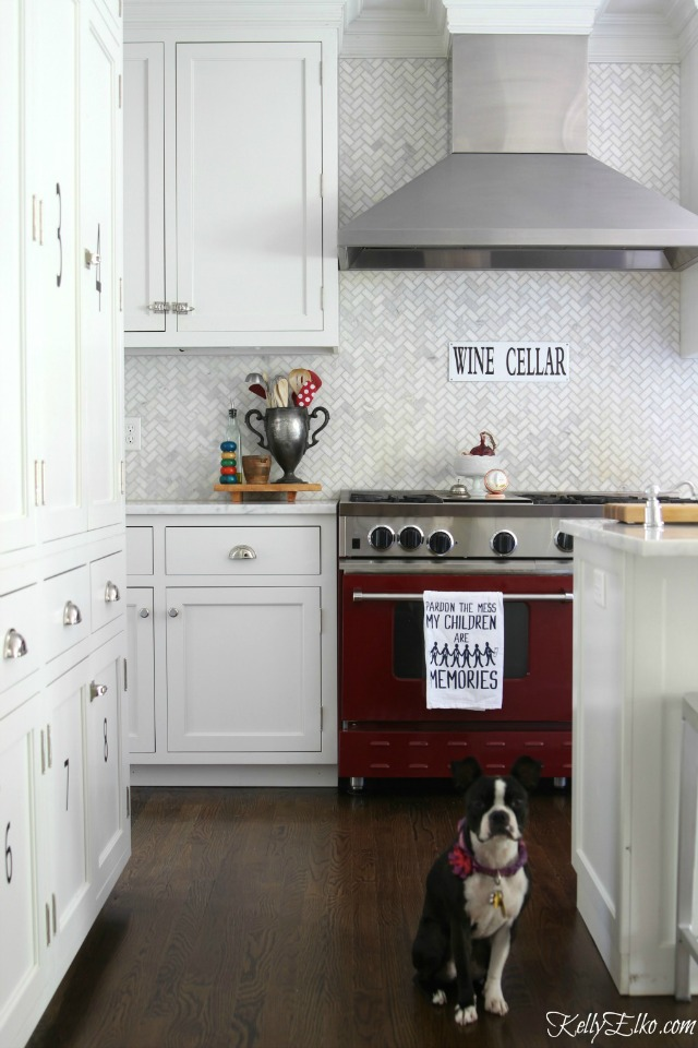 Gorgeous herringbone marble backsplash and red stove kellyelko.com