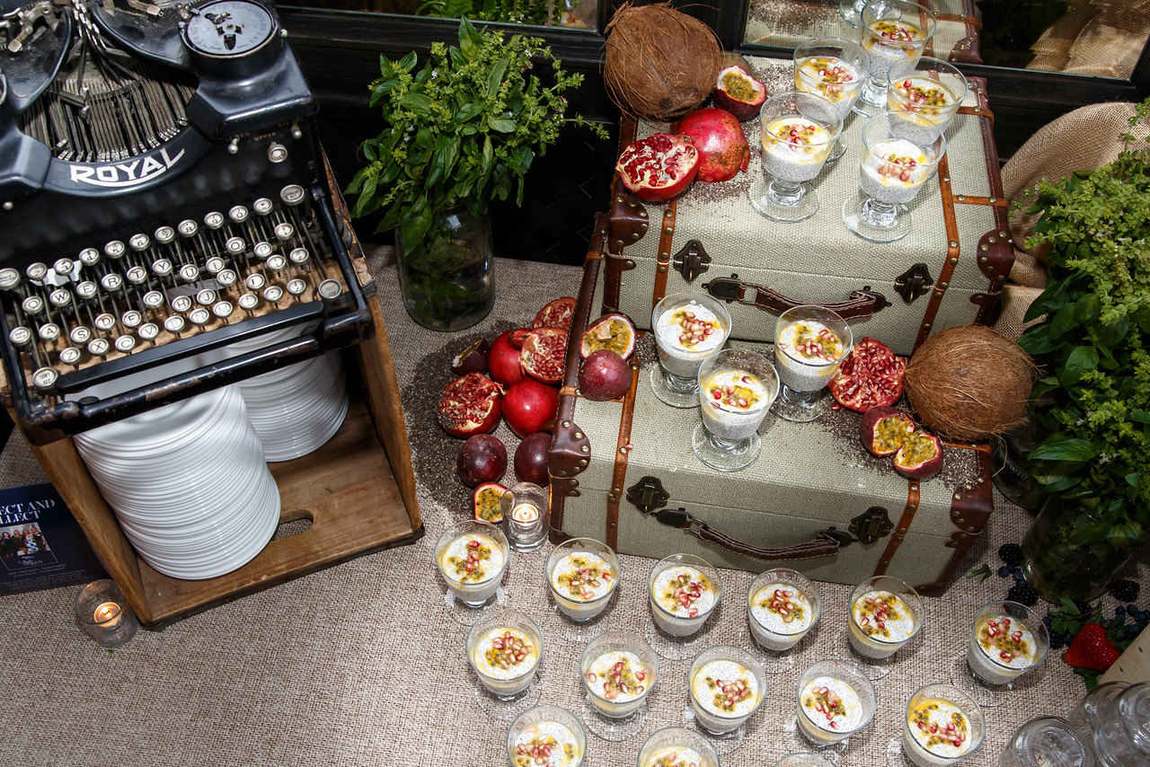Vintage buffet display - love the old suitcases and typewriter kellyelko.com