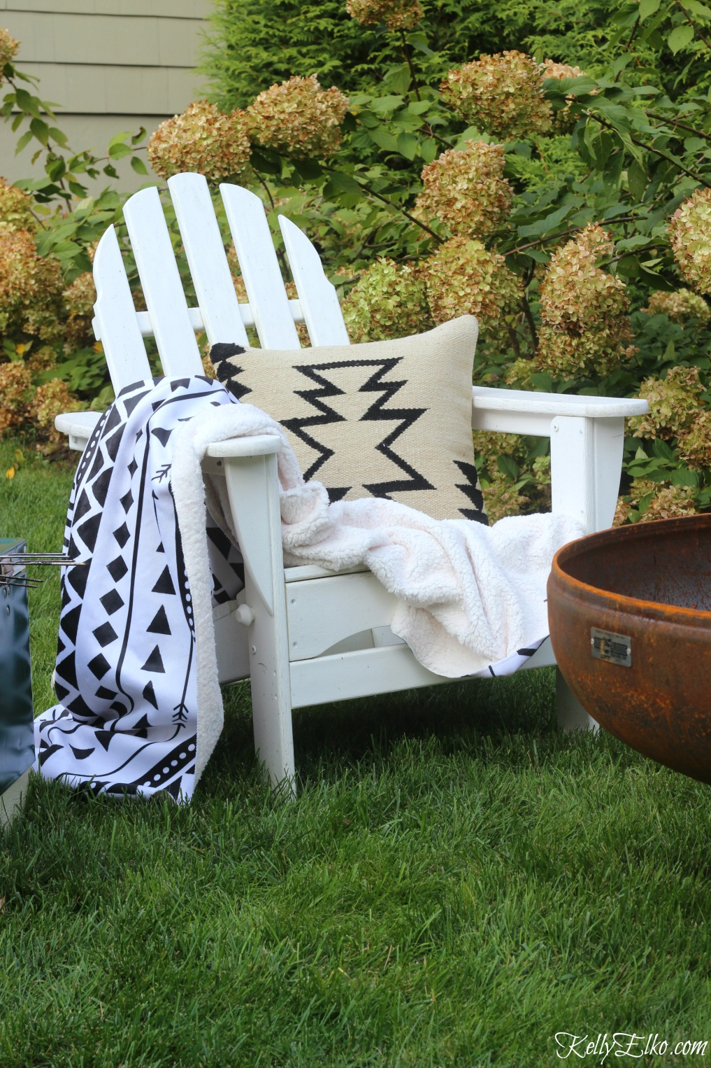 Boho black and white throw and pillow is perfect for a fall fire pit kellyelko.com