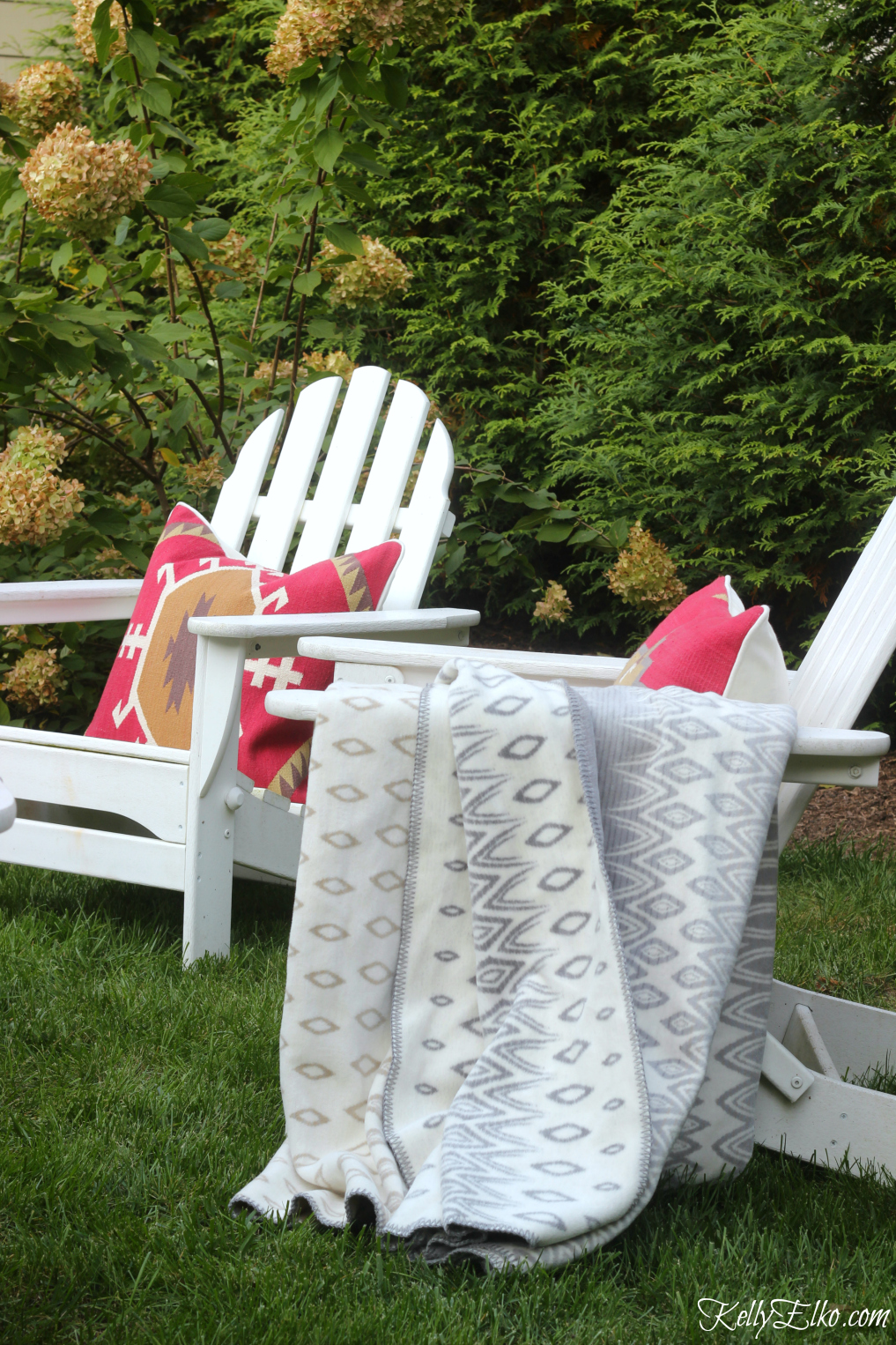 Cozy up outdoor seating with colorful pillows and cozy throws kellyelko.com