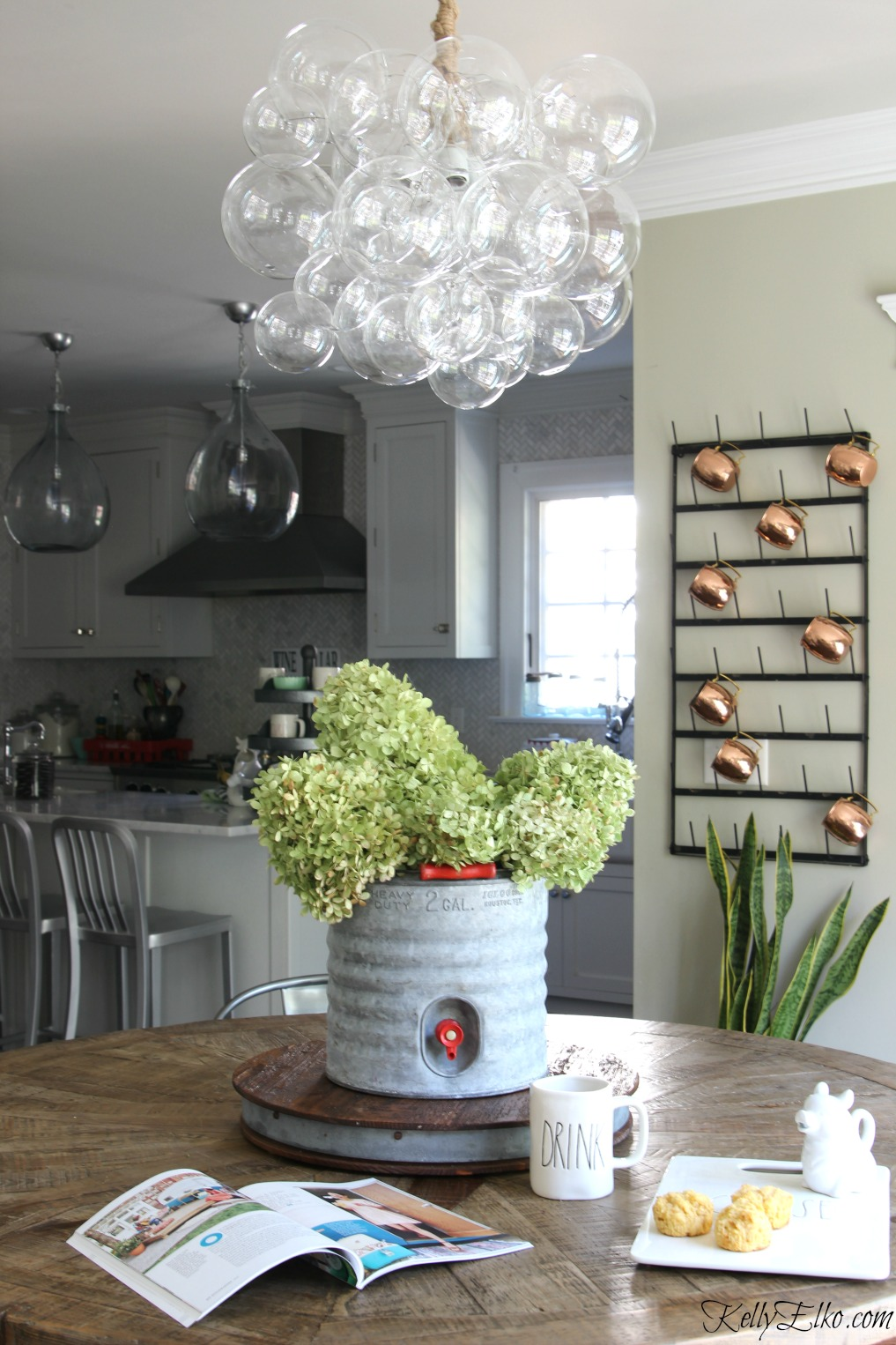 Love the mix of a modern bubble chandelier over a farmhouse table! kellyelko.com