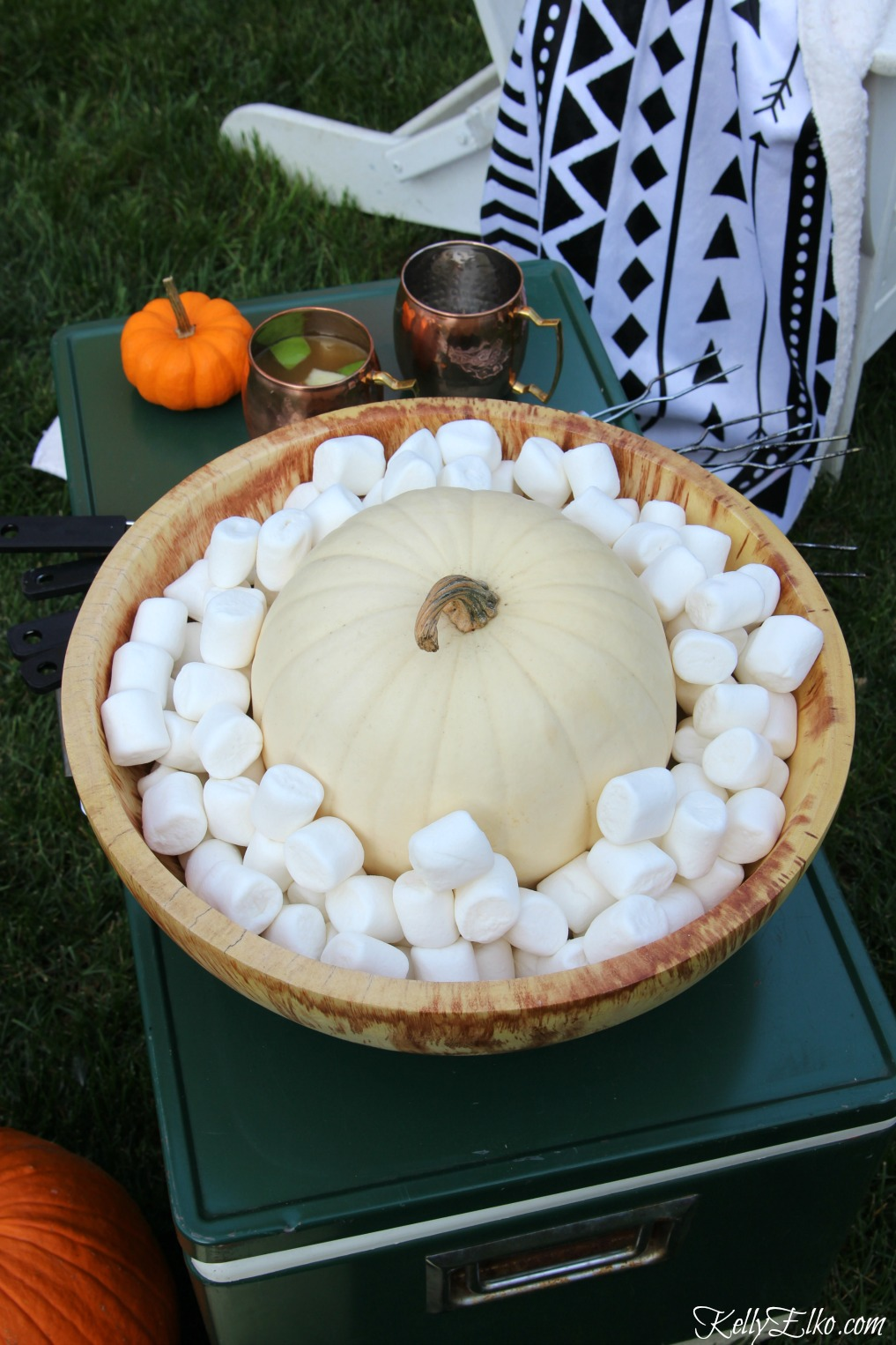 Fall s'mores bar - love this big wood bowl filled with marshmallows and a big pumpkin kellyelko.com