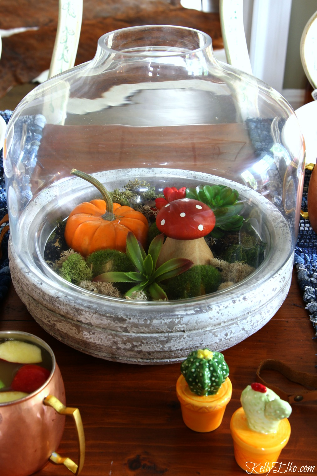 Love this fall terrarium centerpiece kellyelko.com