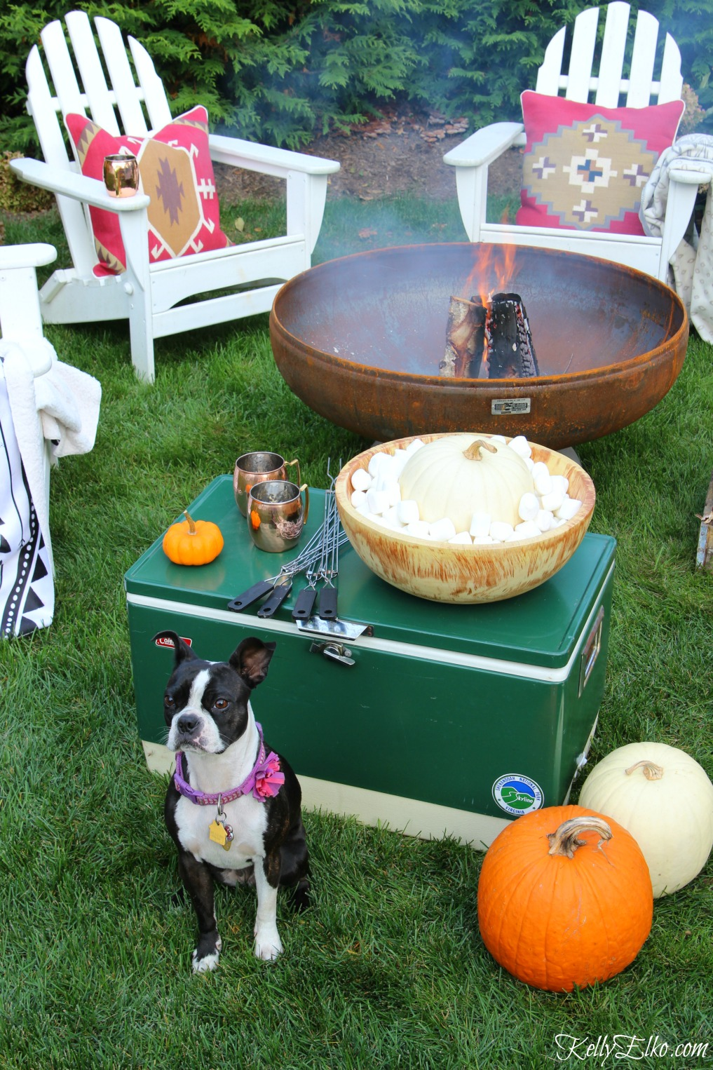 Fall fire pit and smores bar - love the boho pillows and vintage accessories like the old cooler kellyelko.com