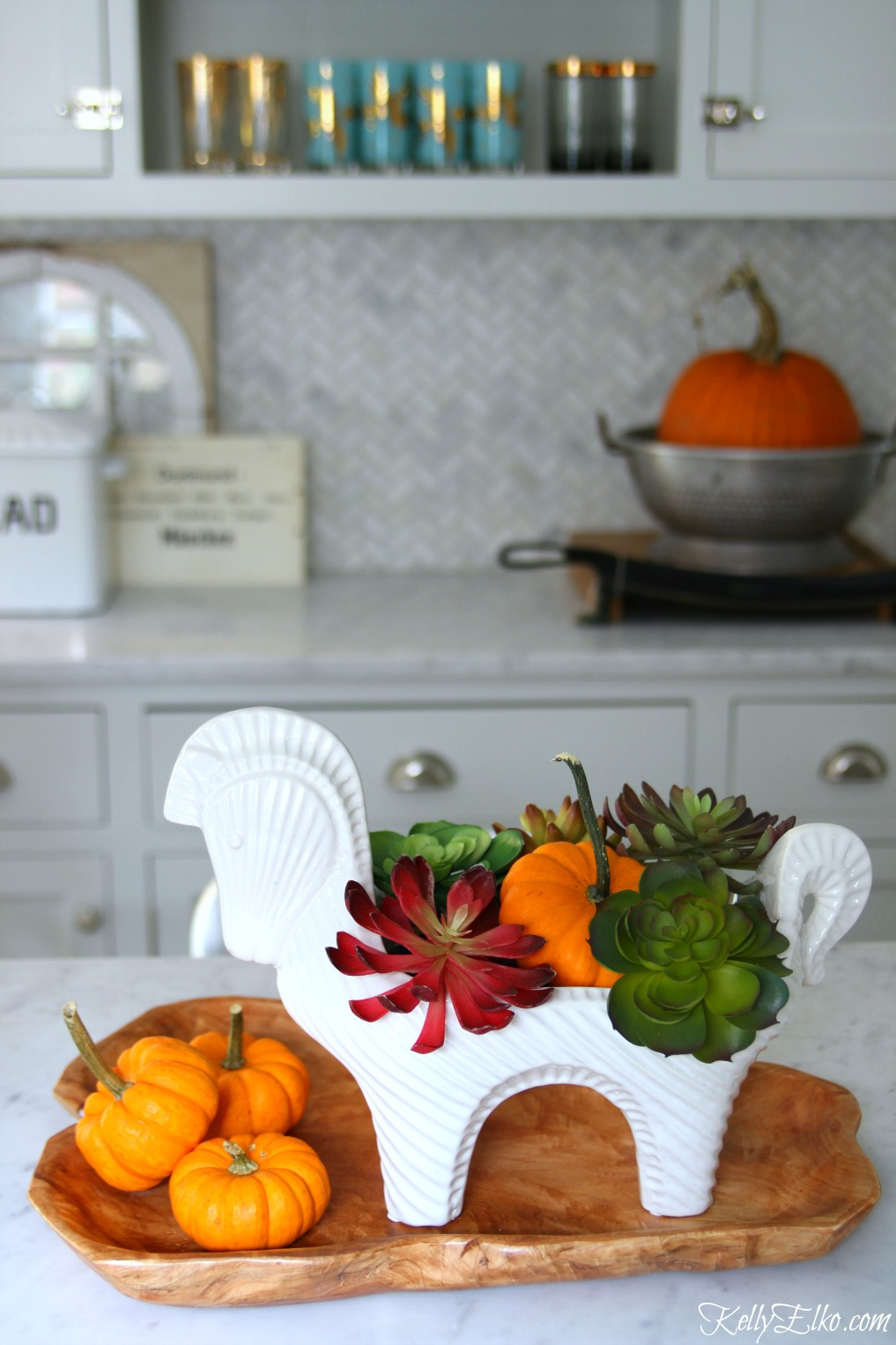 Make a faux succulent centerpiece for fall - LOVE the white horse vessel kellyelko.com