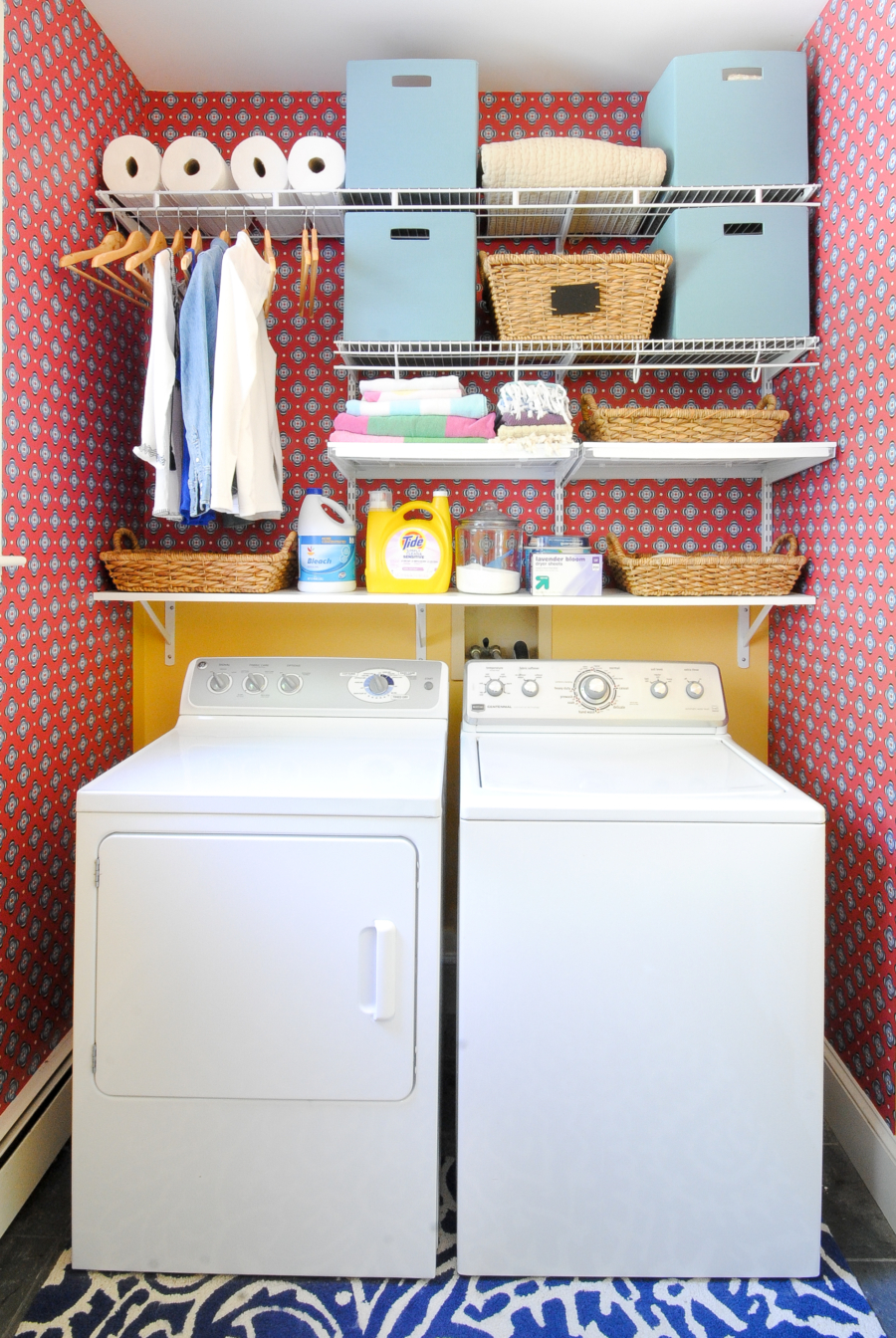 Colorful red and blue laundry room with open shelves