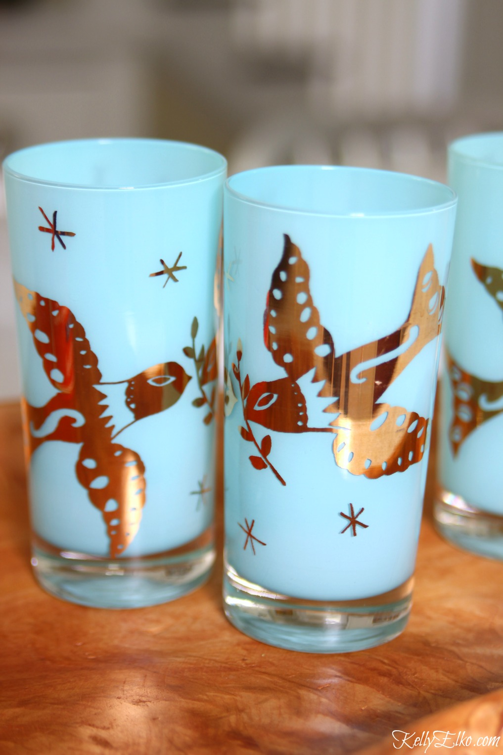 Mid century drinking glasses - love the vibrant blue with gold doves kellyelko.com