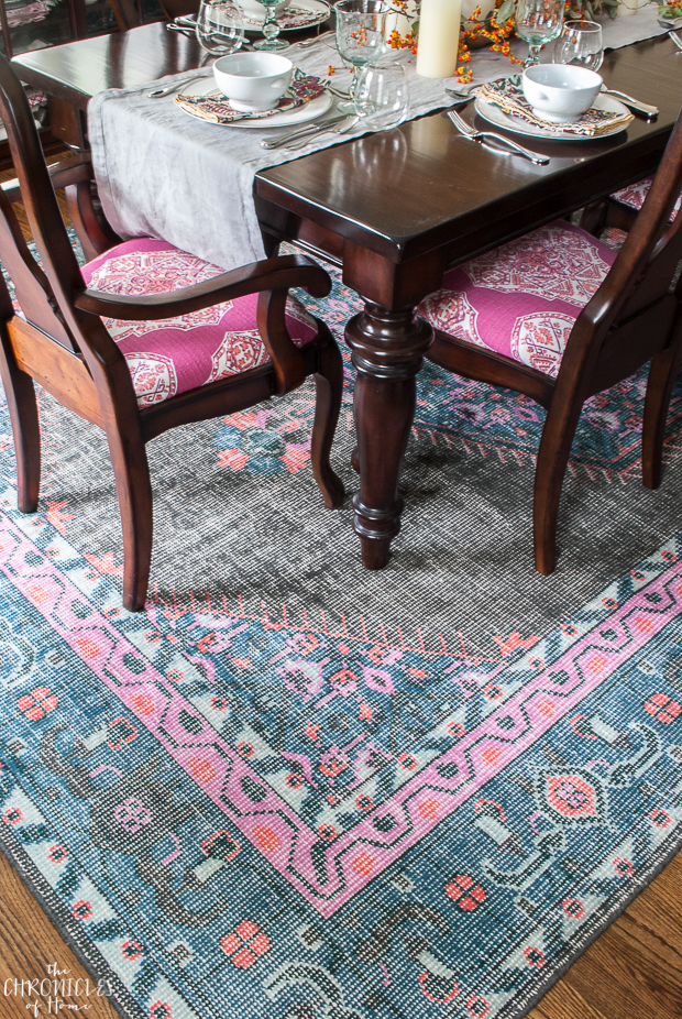 Traditional dining room furniture with vibrant pink and blue fabric