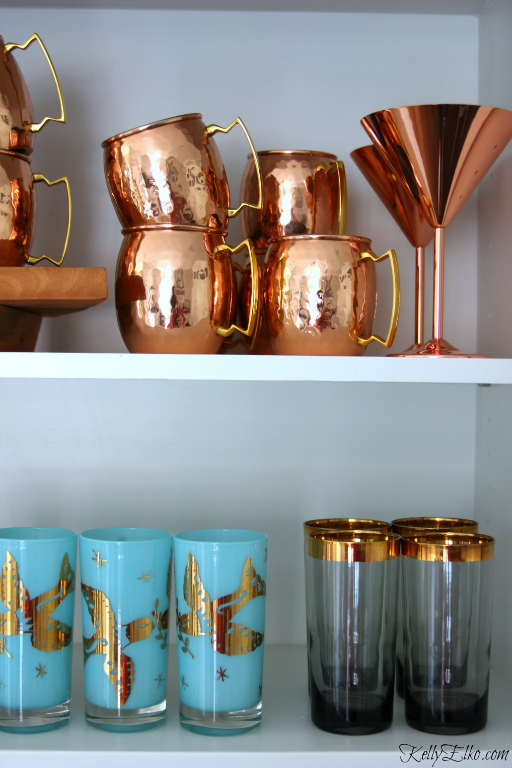 Love the copper moscow mule mugs, rose gold martini glasses and vintage drinking glasses on display kellyelko.com