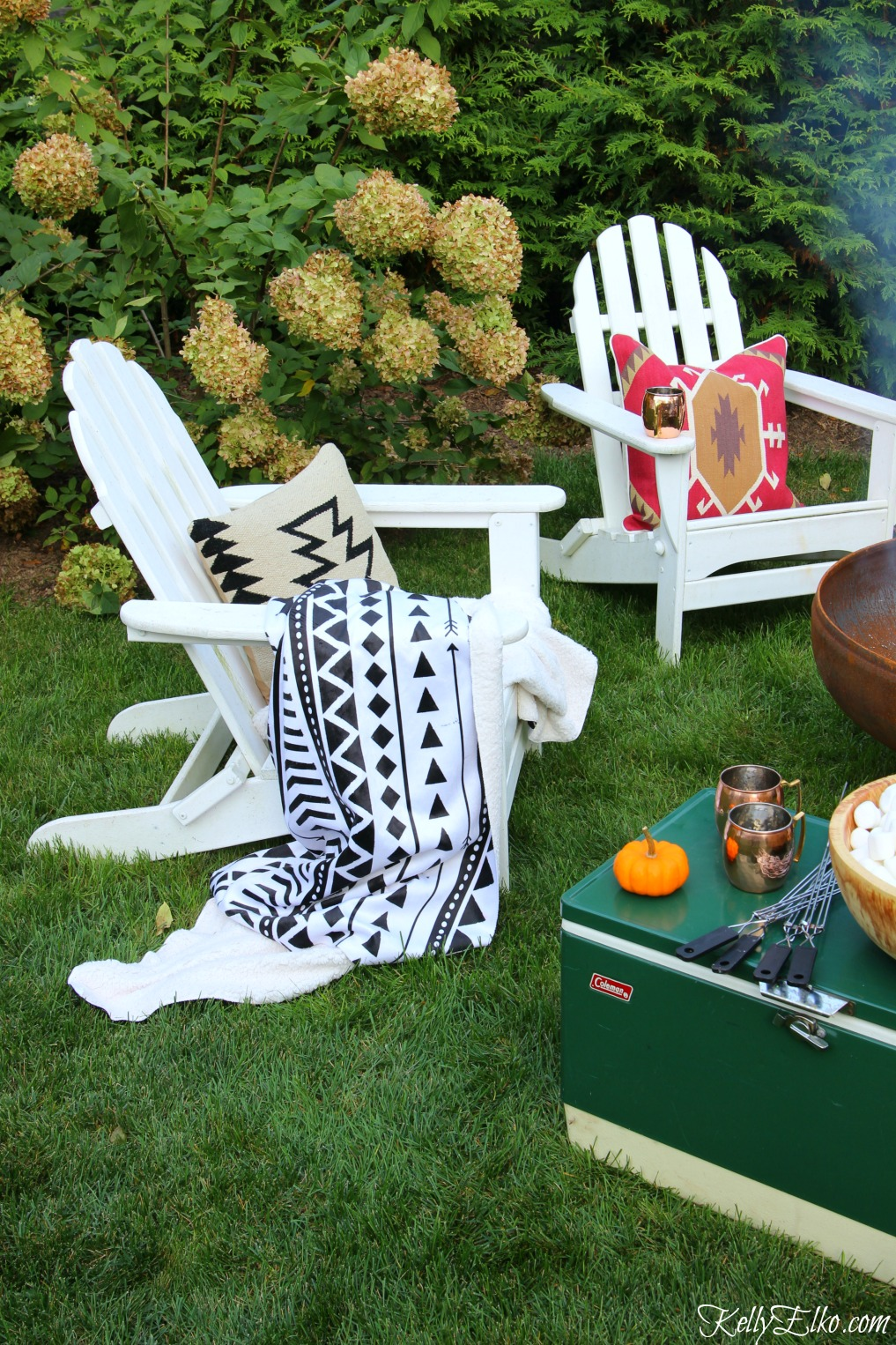 Cozy outdoor seating area - love the boho throws and pillows kellyelko.com