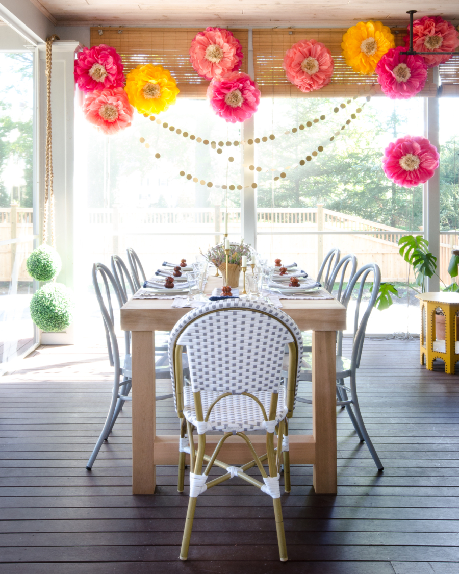 Love this colorful screened in porch with bentwood chairs