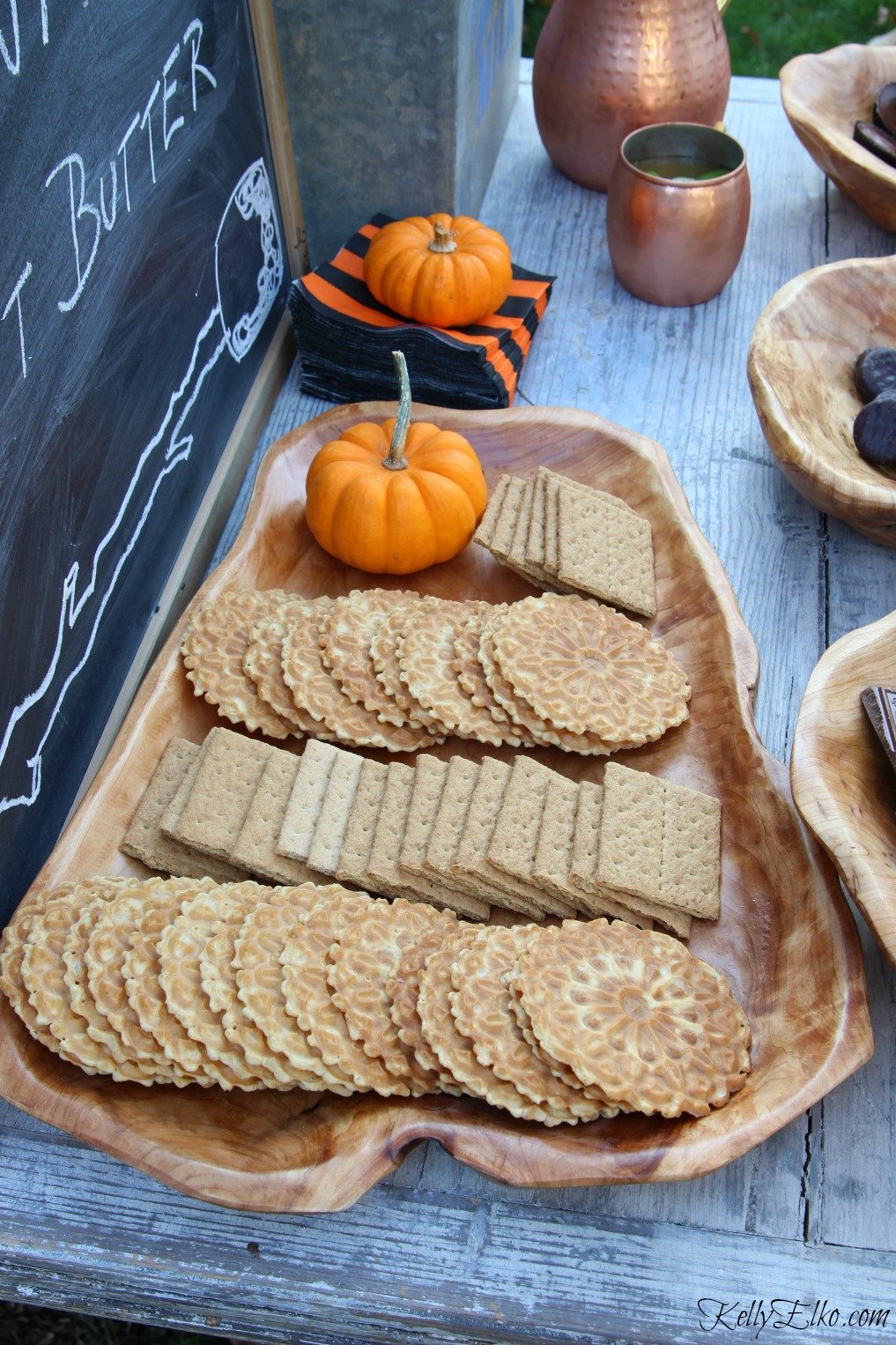Love this wood platter filled with s'mores fixings - graham crackers and pizzelle cookies kellyelko.com