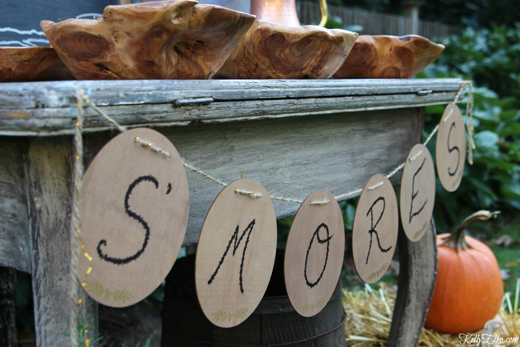 S'mores wood sign on a buffet table kellyelko.com