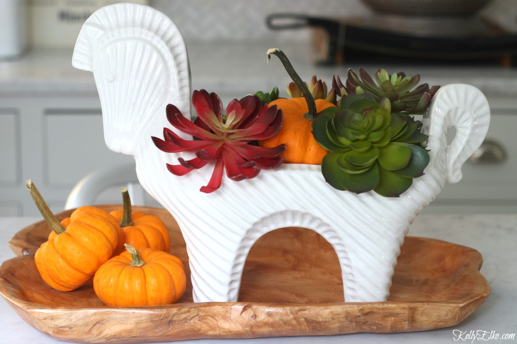 Faux succulent fall centerpiece - love the mid century style horse vessel kellyelko.com